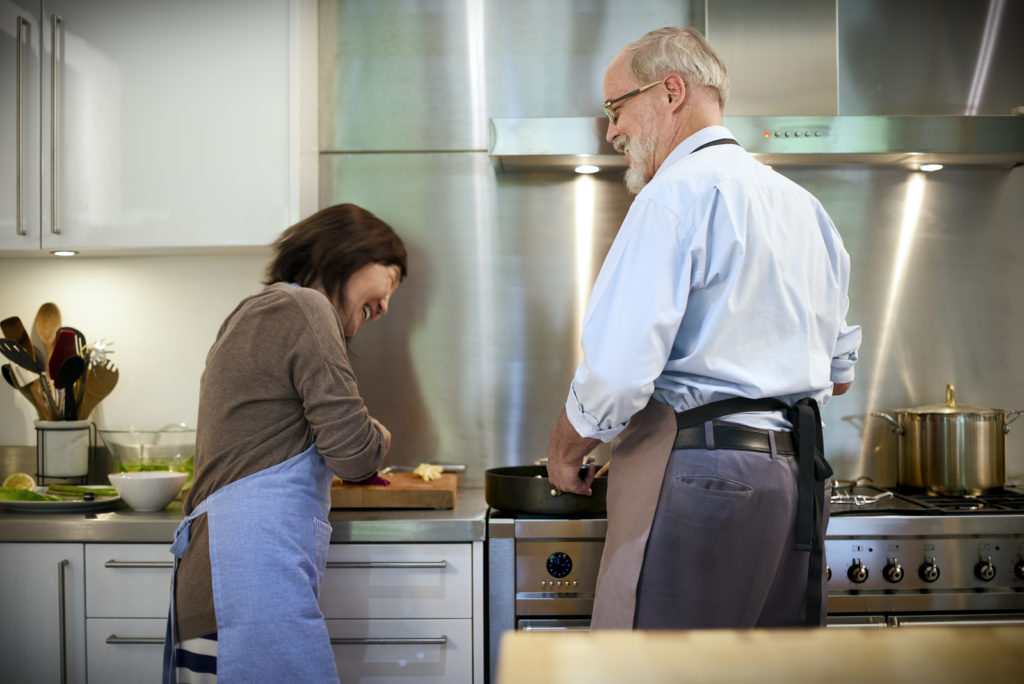 A senior couple cooking together