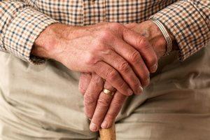 grandparent_hands_resting_on_a_walking_stick