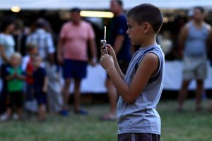child_using_a_mobile_phone